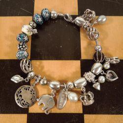 Vintage Spinning sølv armbånd med sølvperler & forskellige charms.