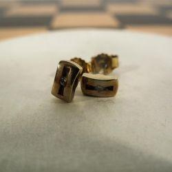 Vintage guld ørestikkere i guld fra Aagaard med zirkon-sten.