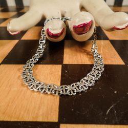 Lækkert vintage sølv-armlænke i et smukt mønster!