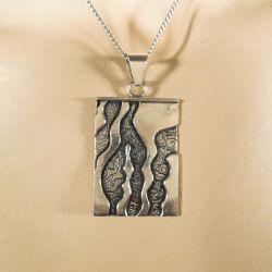 Vintage halskæde med et super lækkert vedhæng i sterling sølv.