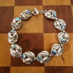 Vintage armlænke fra Herman Siersbøl med blå glas-sten og sterling sølv.